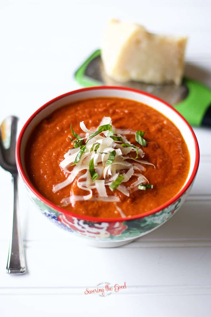 The best oven roasted tomato soup in a floral bowl with silver spoon to the left of the bowl