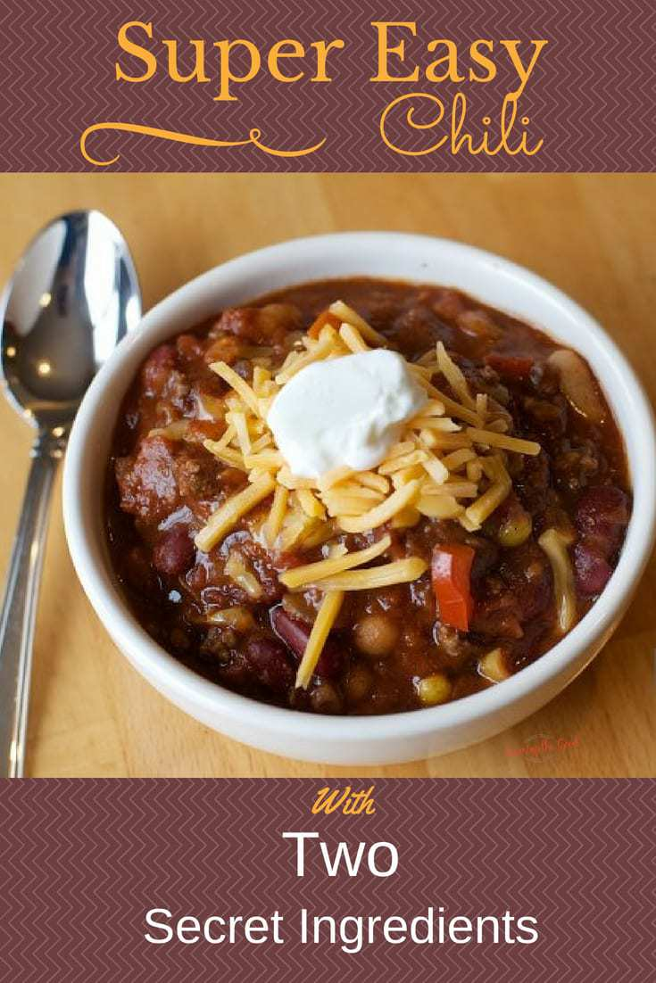 super easy chili in a white bowl with garnish of cheese and sour cream