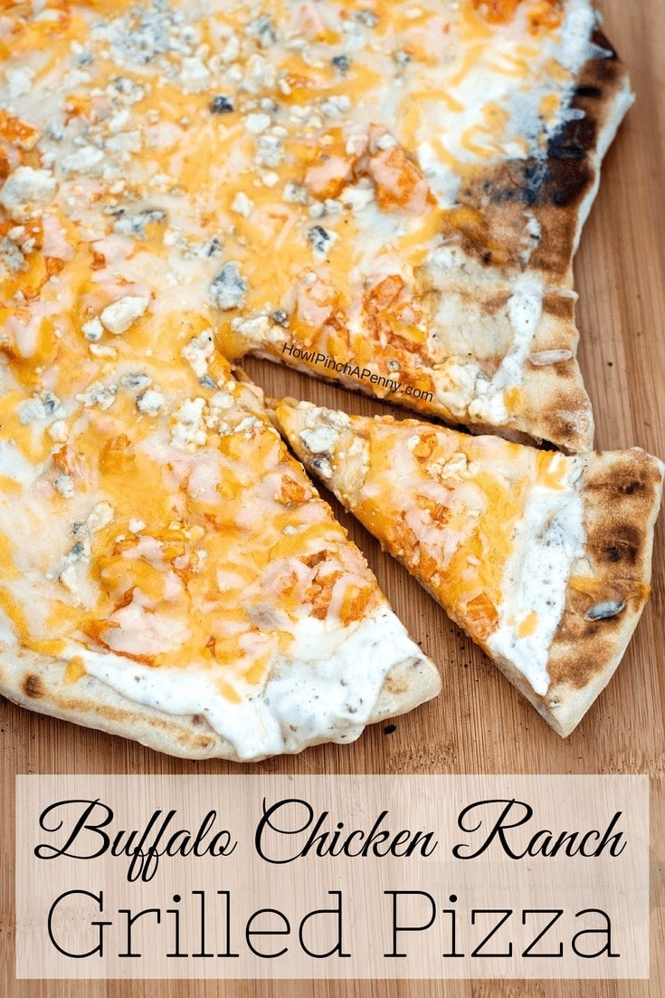 Buffalo Chicken Ranch Grilled Pizza on a bamboo cutting board slice cut away