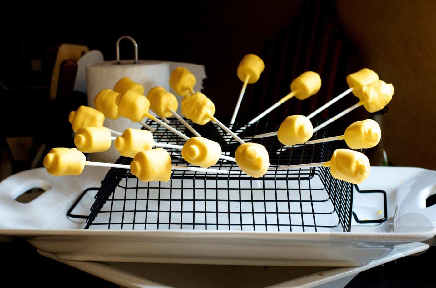 Lego Head Marshmallow Pops drying on a rack