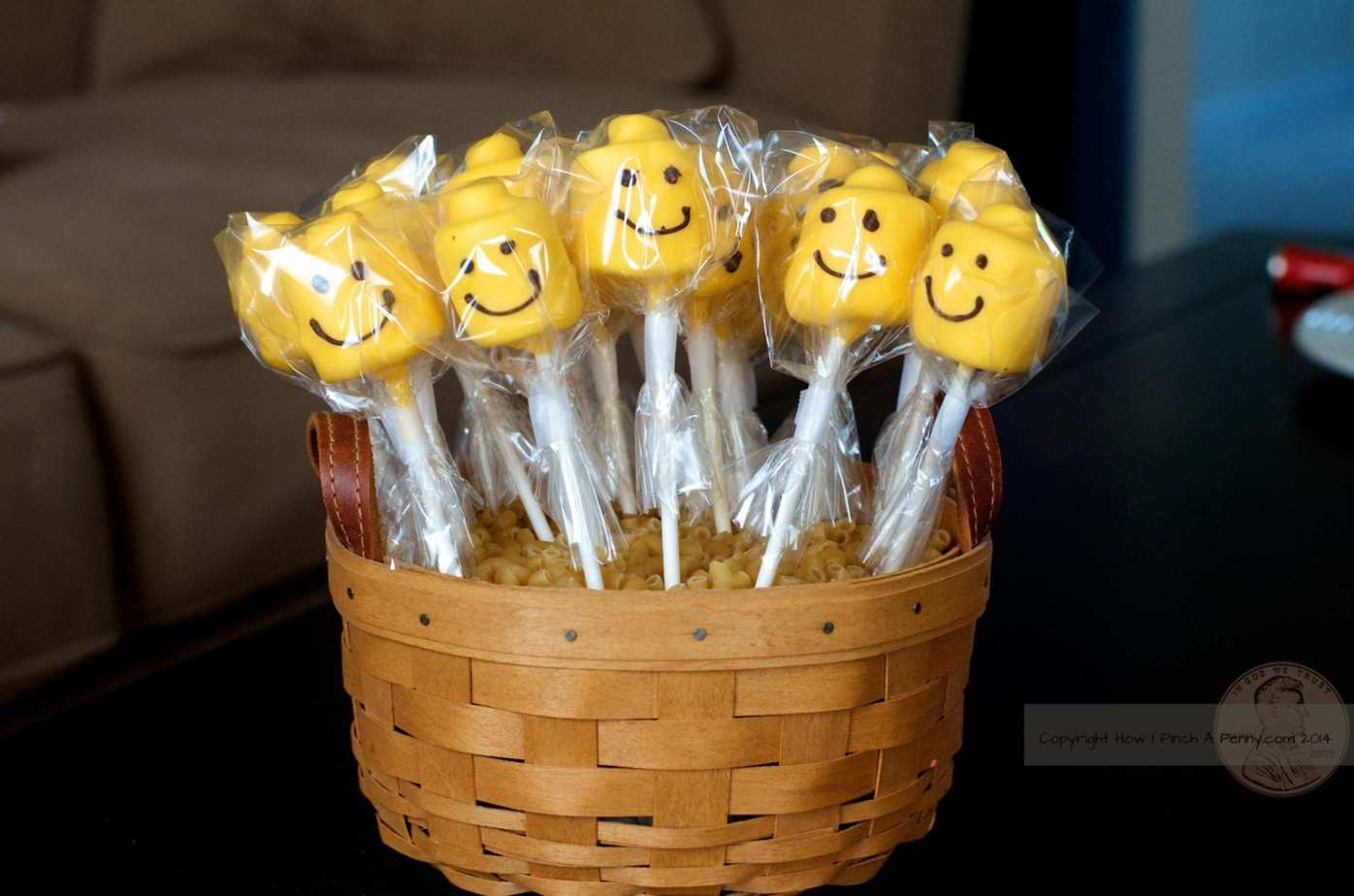 Lego Head Marshmallow Pops ready to be given out. in a longaberger basket