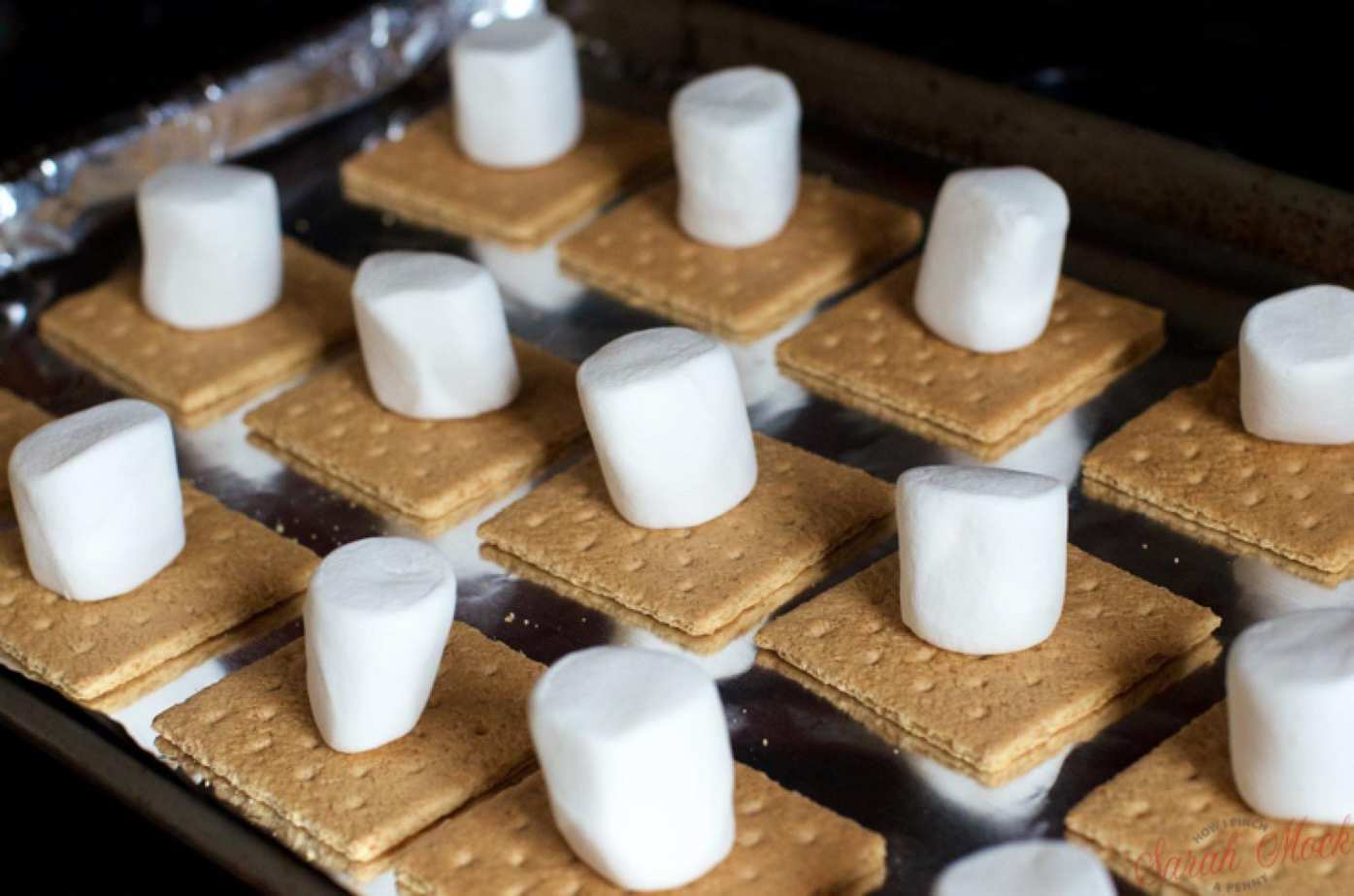 marhsmallows on graham crackers ready to be made into indoor smores