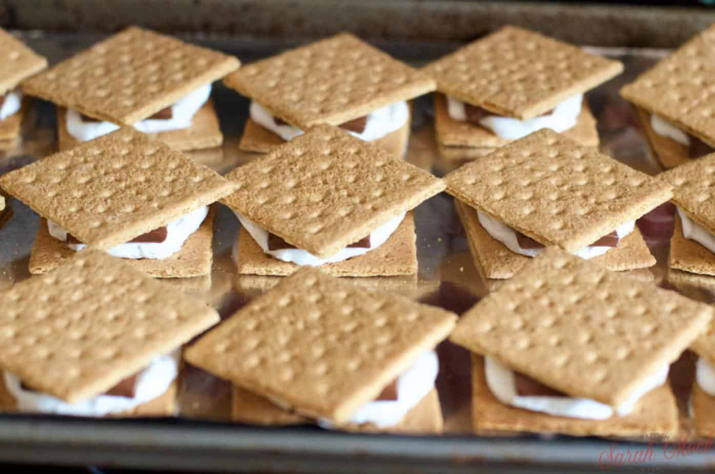completed smores with graham crackers on top of the melted chocolate and warm marshmallows