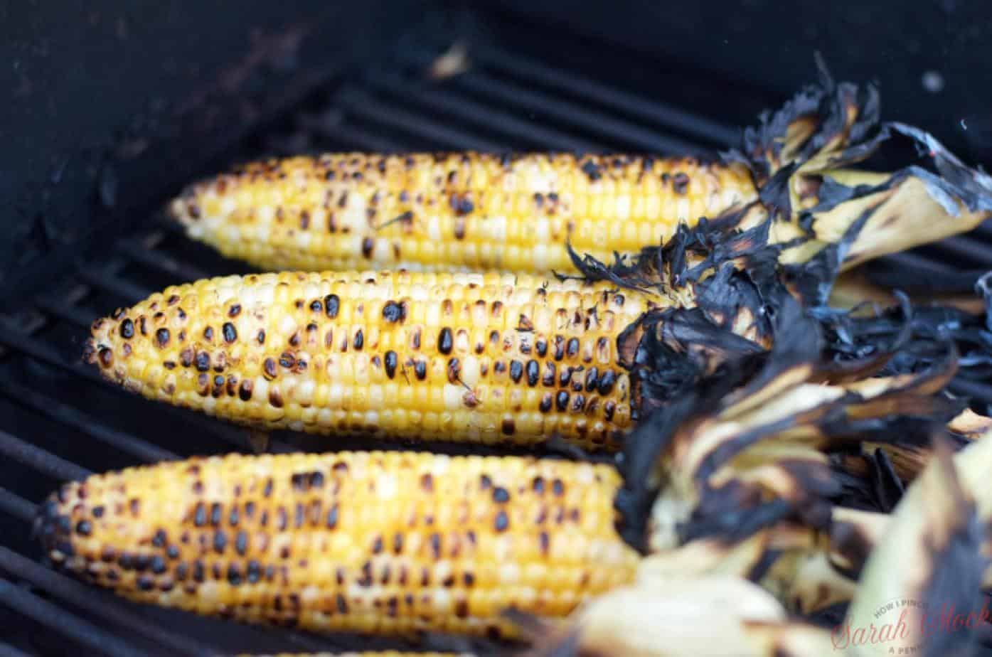 chared corn on the cob on the grill