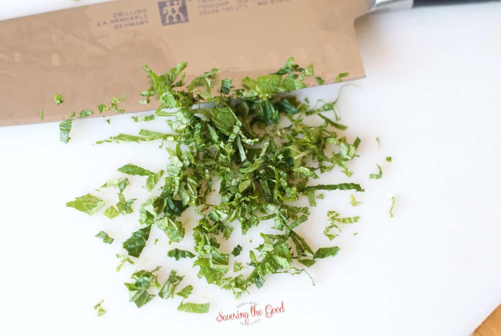 chopped mint on a white cutting board
