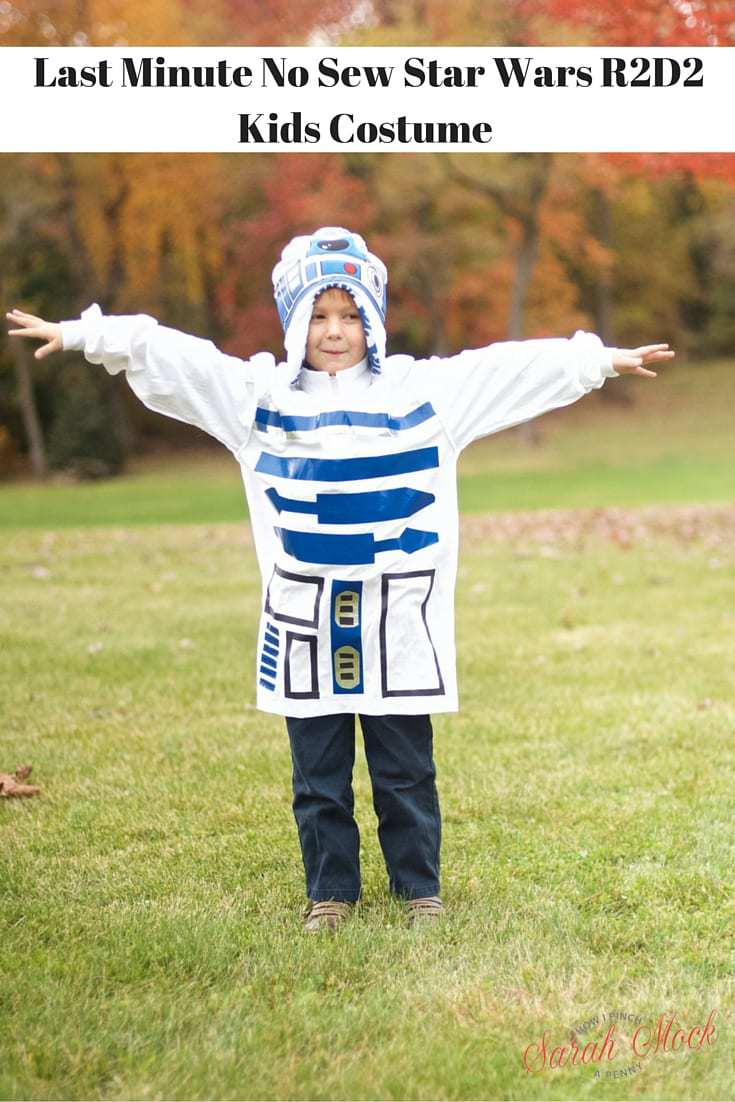 young boy wearing no sew r2d2 costume with his arms out