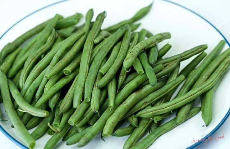 fresh green beans on a plate