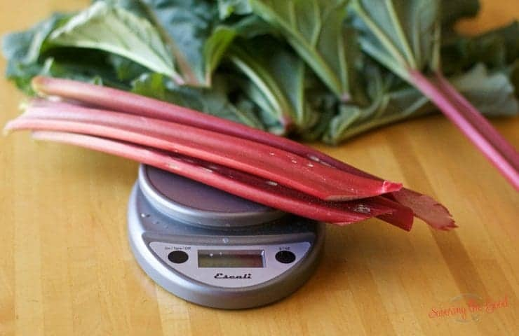 fresh rhubarb on a kitchen scale