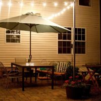 Make your outdoor patio more of an outdoor room by defining the ceiling with bistro lights. But what if you don't have a pergola or trees to attach the lights to? Here are instructions on how to create DIY bistro light patio planters. Further define and personalize your outdoor space with beautiful flowers in the patio planters.
