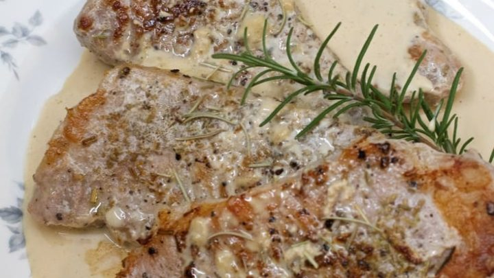 Sous vide boneless pork chops with rosemary garnish.