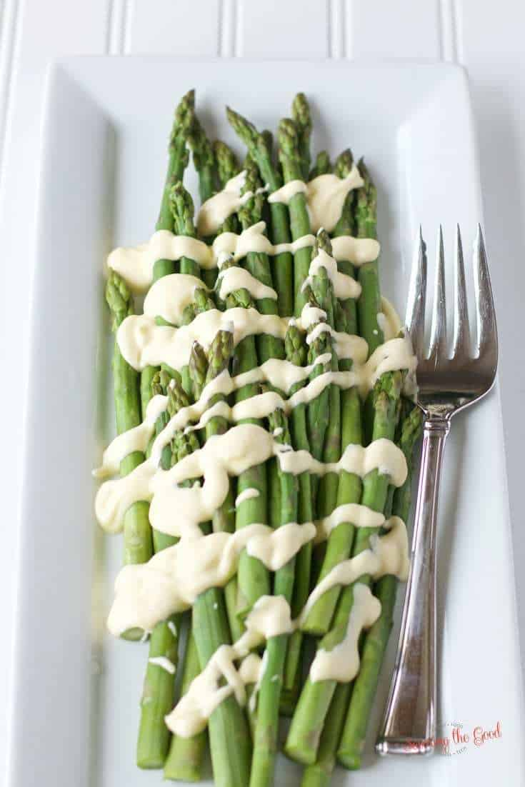 Sous Vide hollandaise on asparagus on a white plate