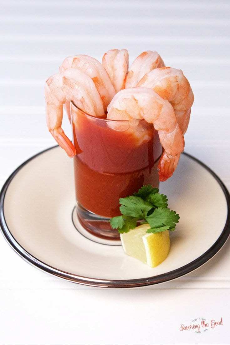 Sous vide shrimp cocktail with lemon garnish