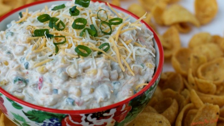 Mexican corn dip is a family favorite and usually disappears faster than it should. My easy Mexican corn dip recipe features Mexicorn, roasted green chilies as well as shredded cheese. I serve my Mexican corn dip with Fritos but any scoop-able chip will work. Now you know how to make Mexican corn dip! #mexicancorndip #corndip #chipanddip #fritos #diprecipe