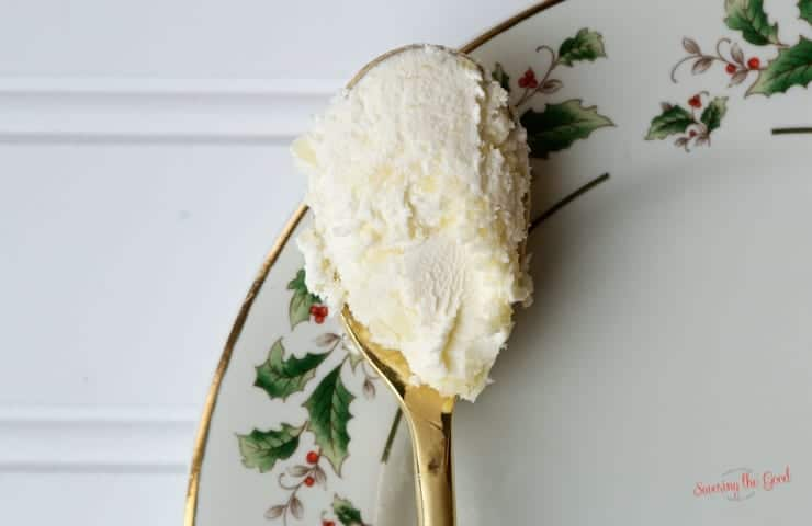Homemade clotted cream on a gold spoon