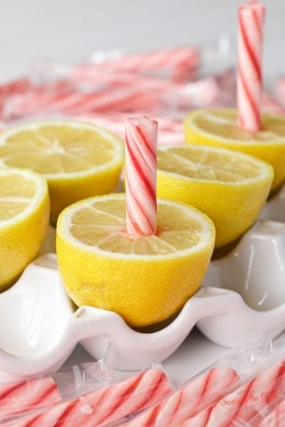 Lemon peppermint stick also known as Baltimore lemon stick or FlowerMart lemon peppermint stick. No matter what you call it, this soft peppermint stick and fresh lemon is the perfect balance of sweet, sour and sticky. Lemon peppermint stick is a Baltimore tradition that a must for summer fairs, fundraisers, backyard and block parties. #fundraiser #baltimore #lemonstick #lemonpeppermintstick #streetfood