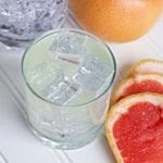 Making homemade grapefruit infused gin is super easy to make by the traditional method but when you need grapefruit infused gin in a shorter amount of time, try this sous vide method. I love a refreshing gin and tonic and experimenting with gin infusions has expanded the customization of my favorite gin cocktail. Sous vide infused gin is the fastest way I have found to make a custom infused gin.#gin #infusedgin #sousviderecipe #sousvidegin #gincocktail #grapefruitgin