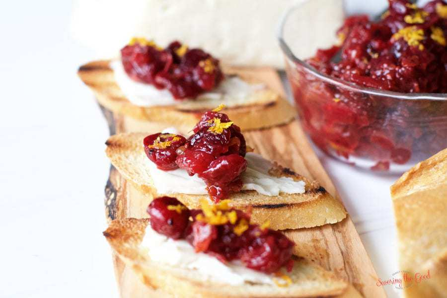 Cranberry chutney on warm brie crostini