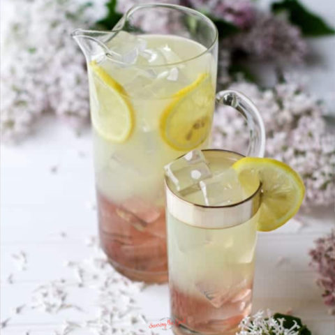Lilac Lemonade in a glass pitcher