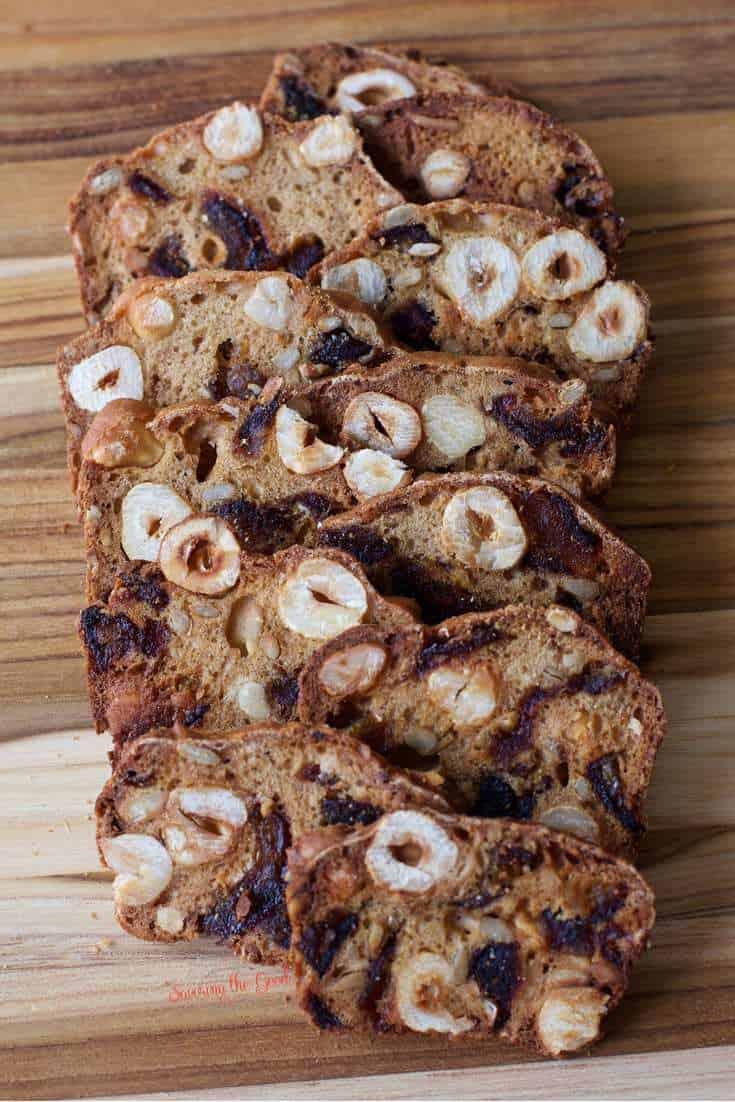Almondina Hazelnut Date Thins on display sitting on a bamboo cutting board