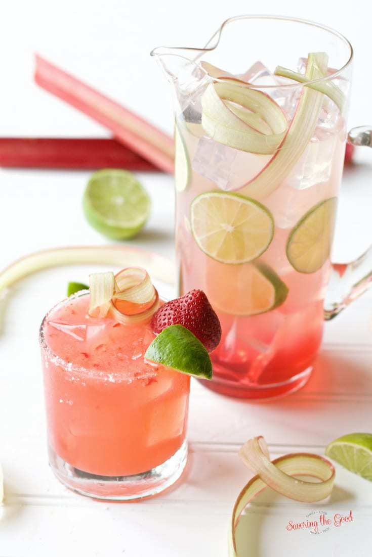Strawberry Rhubarb Margarita with pitcher of Strawberry Rhubarb Margarita