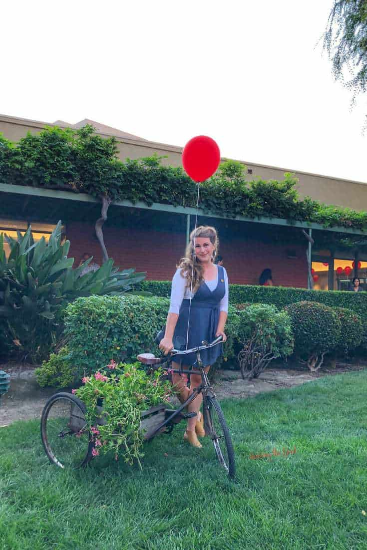 Christopher Robin Red Carpet Sarah Mock with trike and red baloon