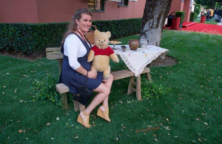 Christopher Robin Red Carpet sarah mock with pooh bear