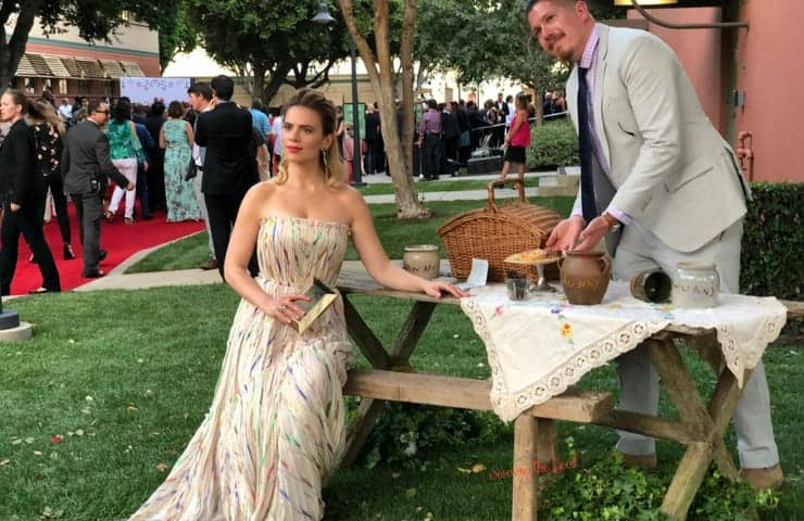 Christopher Robin Red Carpet Hayley Atwell seated at picnic table