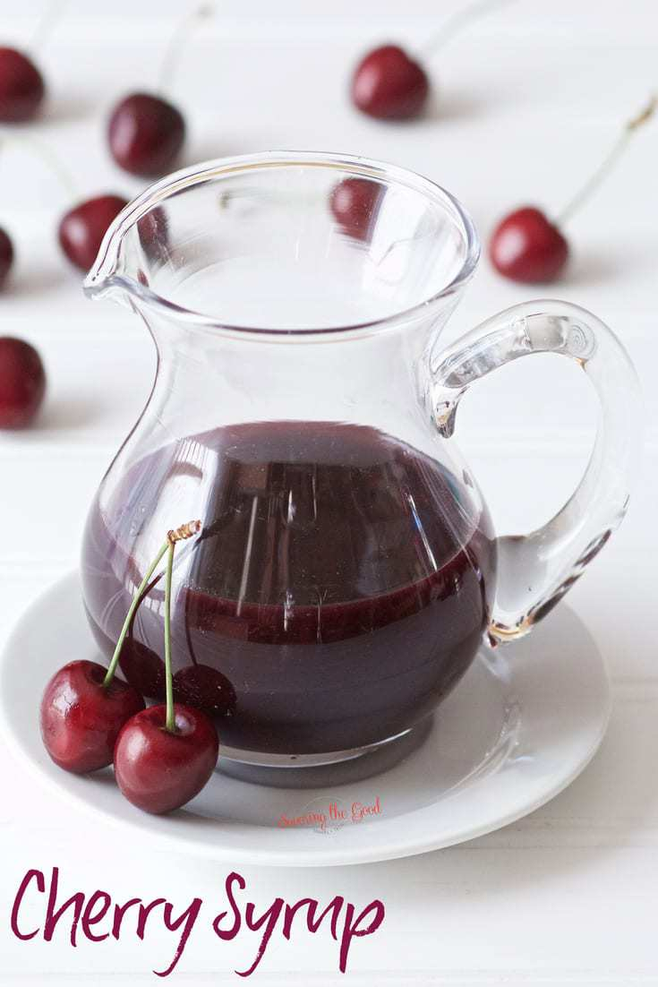 cherry syrup in a clear glass pitcher 'cherry syrup' text in lower left corner