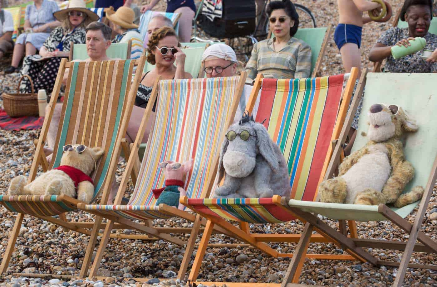 Winnie the Pooh, Piglet, Eeyore and Tigger relax at the beach in Disney's CHRISTOPHER ROBIN.