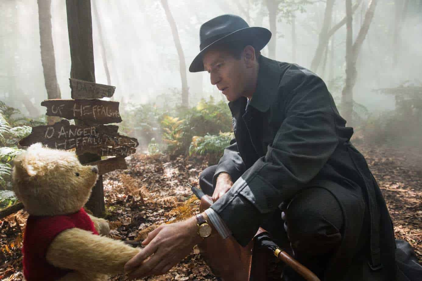 Christopher Robin (Ewan McGregor) with his long time friend Winnie the Pooh in Disney's live-action adventure CHRISTOPHER ROBIN.
