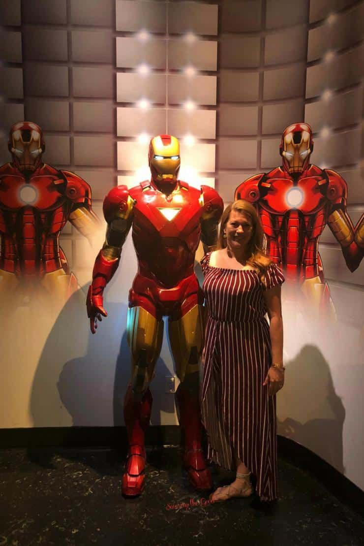What is new at Madame Tussauds Hollywood posing with Iron Man costume