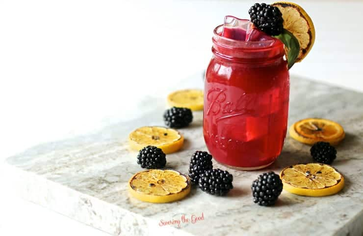 horizontal image of Blackberry Bourbon Lemonade on a marble surface