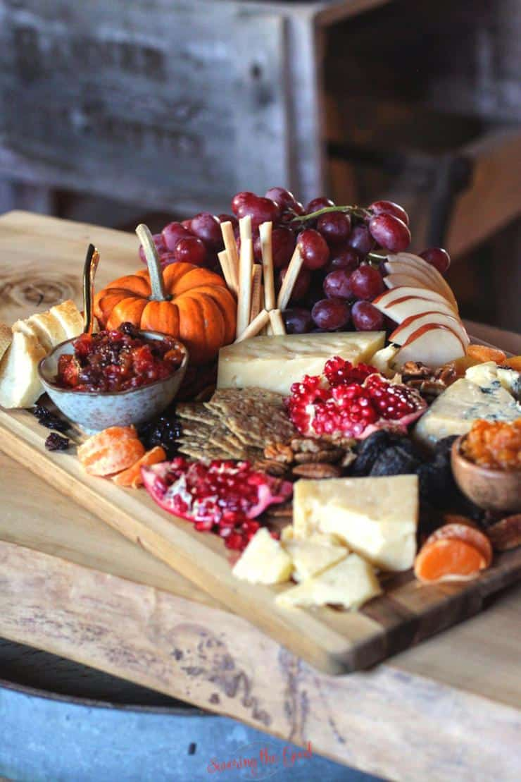 farm table cheeseboard with fall decorations