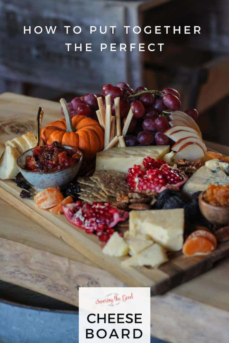 cheese board assembles with multiple cheeses