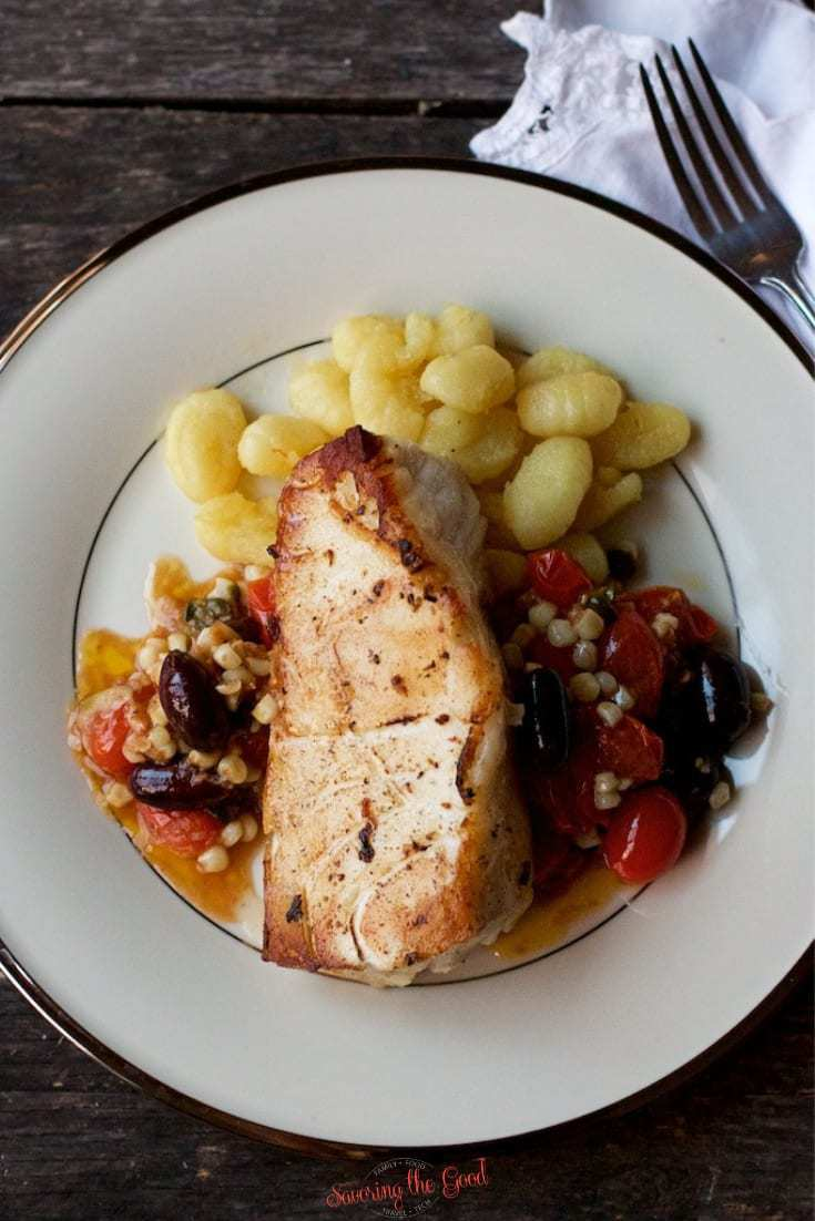 sous vide sea bass with tomatoes, corn olives and capers