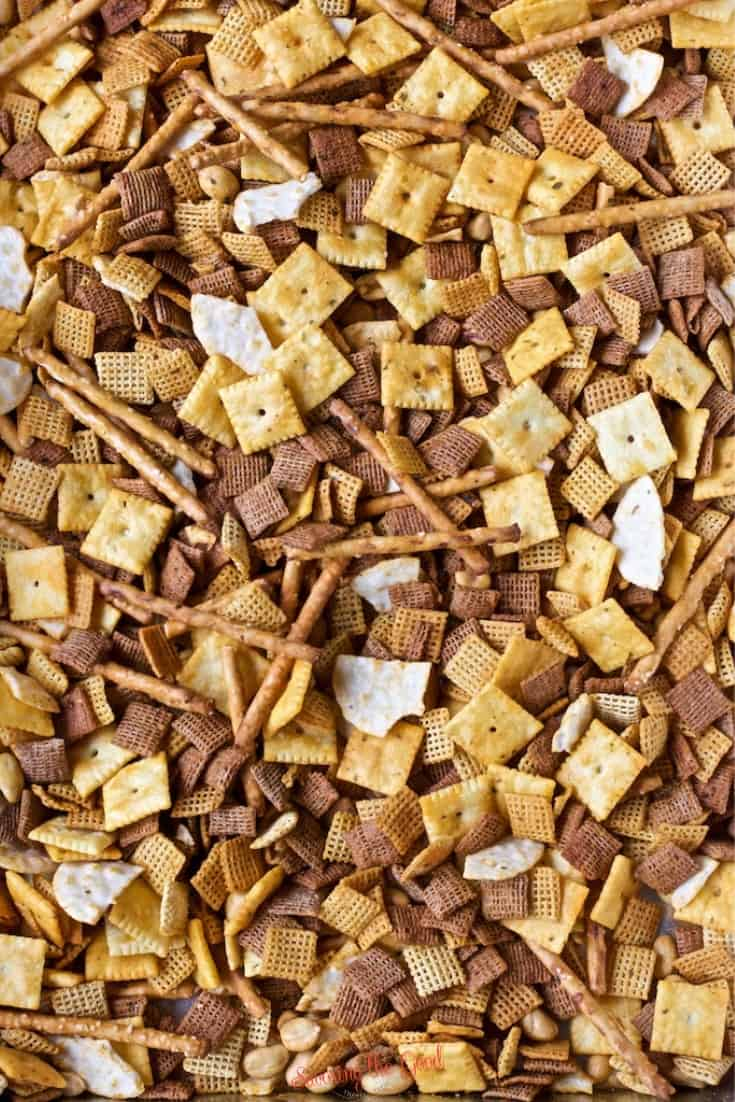 Buffalo Chex Mix Ingredients mixed in a pan