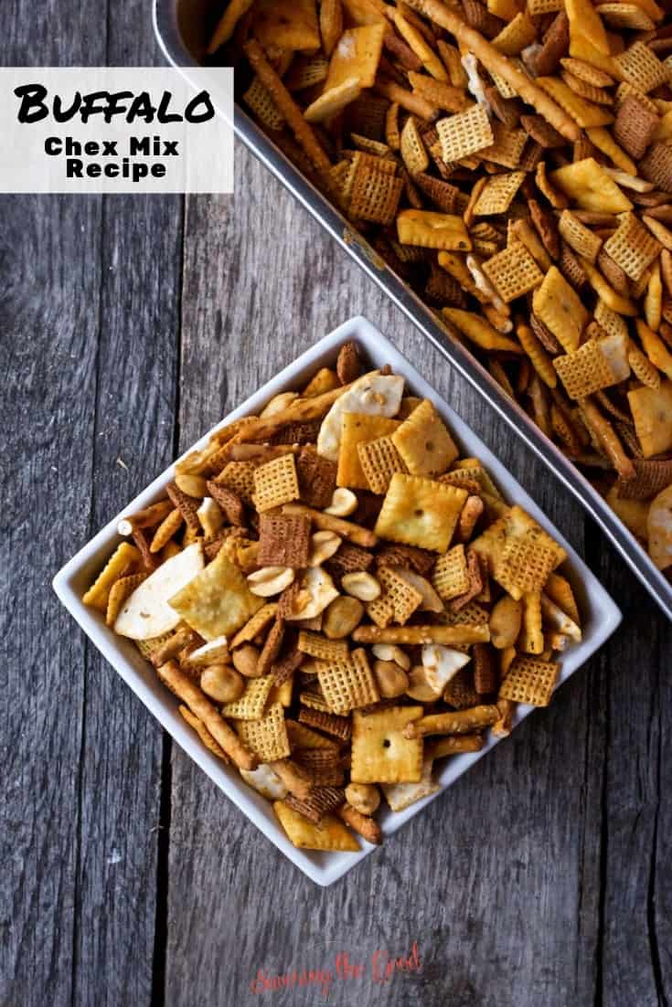 Buffalo Chex Mix in a bowl with the pan above on a wooden surface