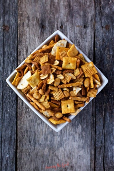 Buffalo Chex Mix in a square bowl