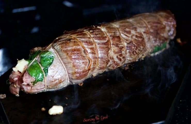 sous vide stuffed flank steak getting a presear on a hot grill