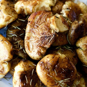 Sous Vide Potatoes on a plate with rosemary garnish