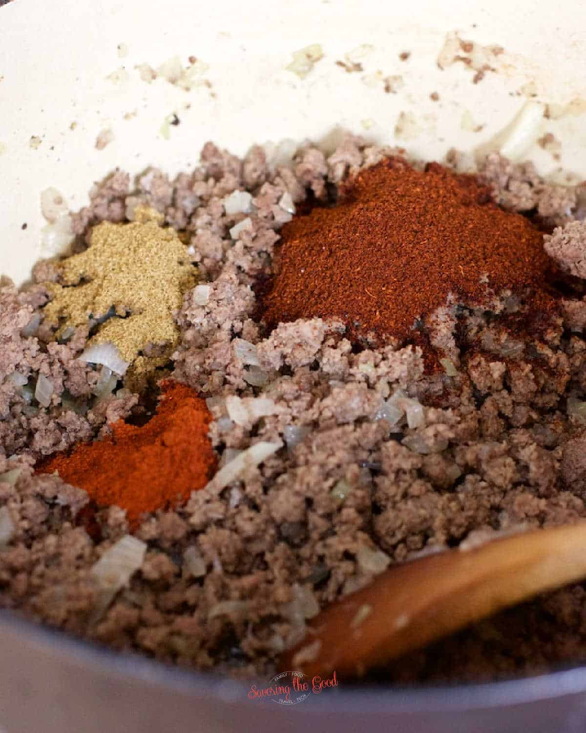 Beanless Chili ingredients in a large pot featuring the spices