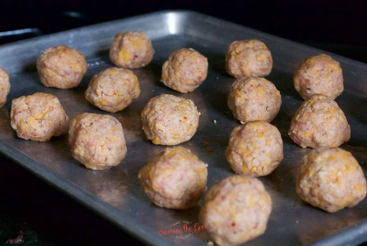 raw Bisquick Sausage Balls on a sheet tray