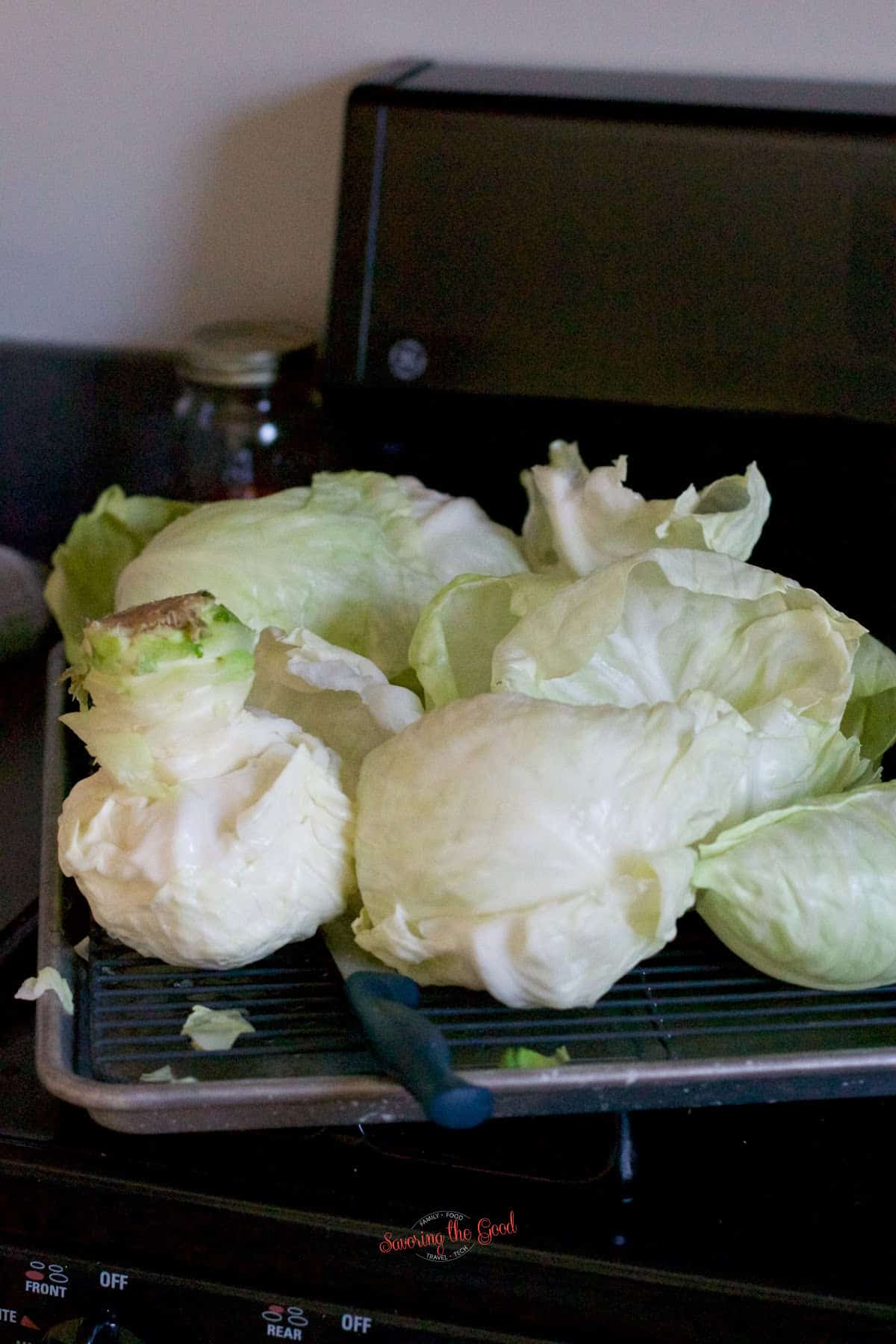steamed cabbage leaves on a tray