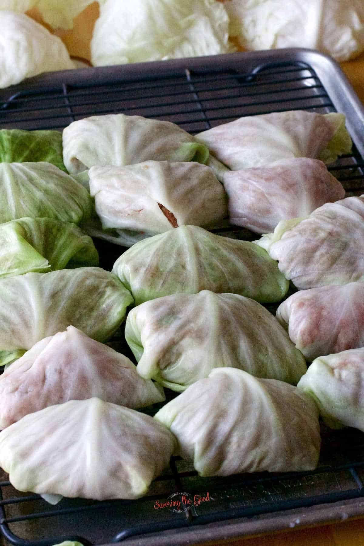 stuffed cabbage rolls rolled resting on a cookie rack