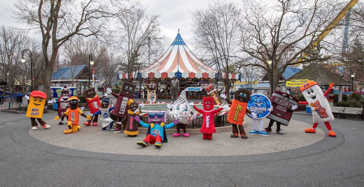 hersheypark characters in front of the carousel