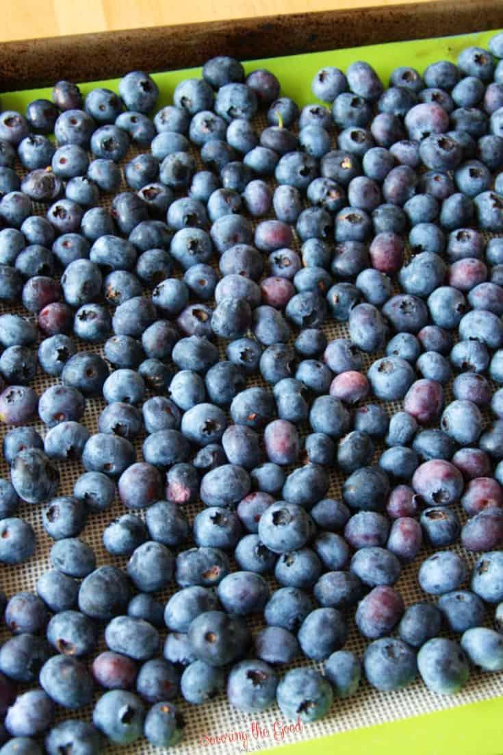 frozen blueberries on a cookie sheet