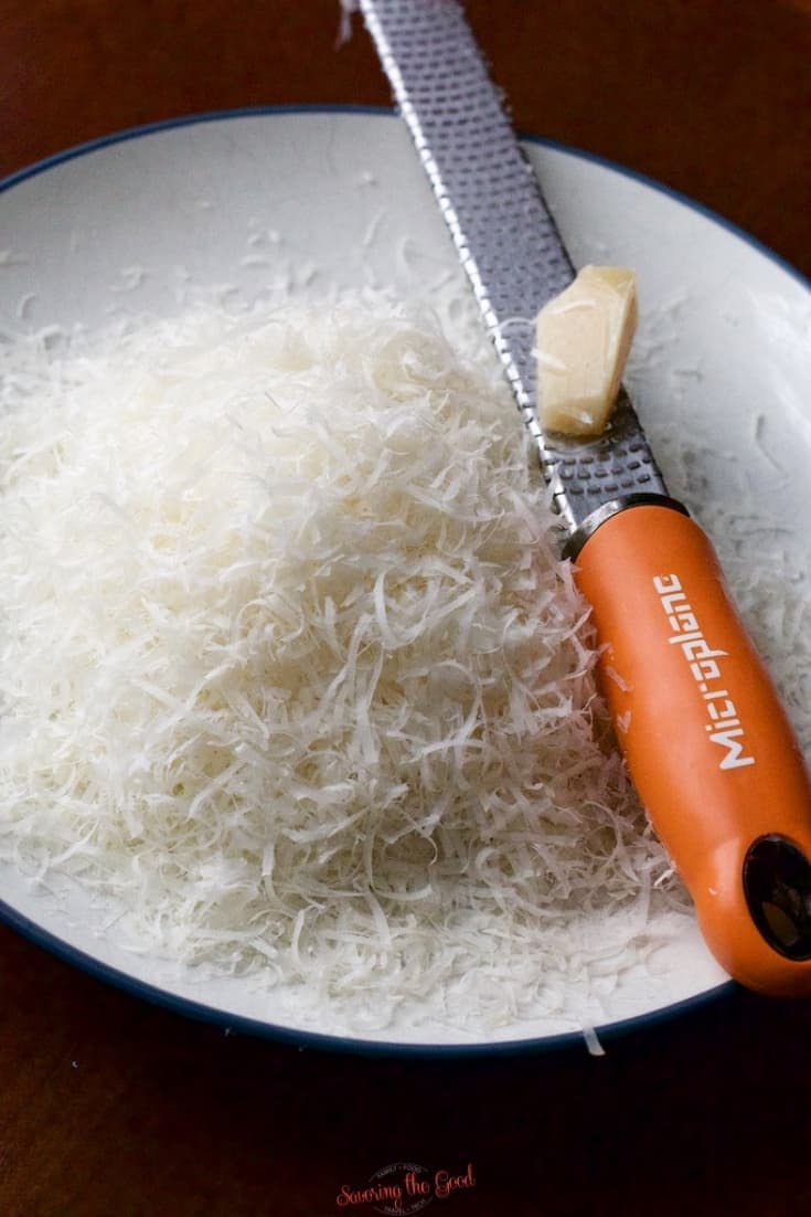 freshly grated parmesan cheese on a plate