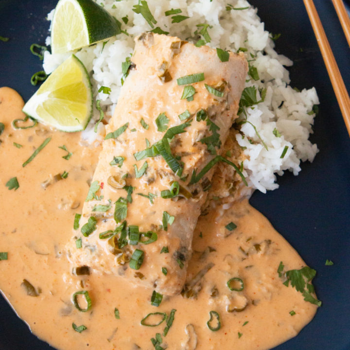 Sous Vide Mahi-Mahi with Thai Coconut Curry Sauce on a blue plate with white rice