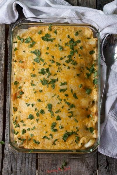 Garnished pan of sour cream chicken enchiladas