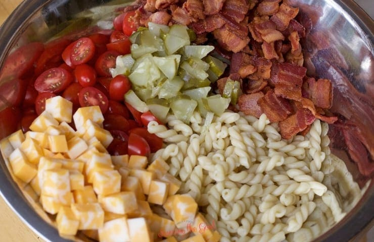 Dill Pickle Pasta Salad ingredients in a bowl, ready to be tossed